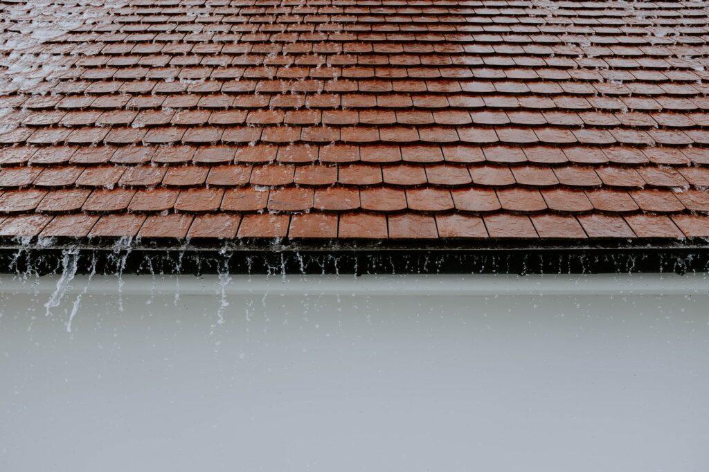 photo of roof while raining